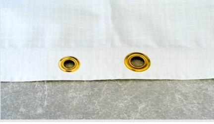 Grommet for plastic sheeting