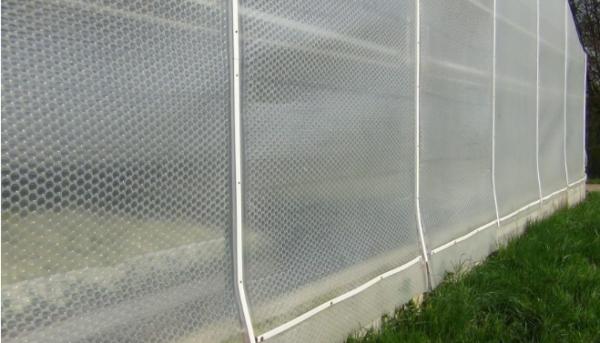 Greenhouse plastic side curtain