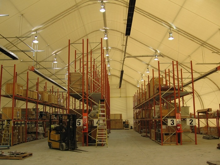 Plastic sheeting covered fabric building.jpg